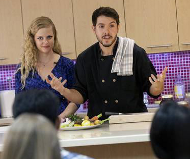Image of Geremy and Christy during a cooking demonstration