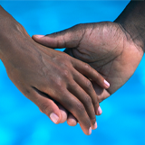 Image of a close up of two hands holding each other