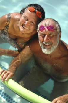 Image of a man and woman swimming