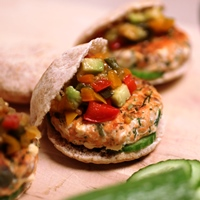 Image of super salmon sliders with bell pepper and avocado relish.
