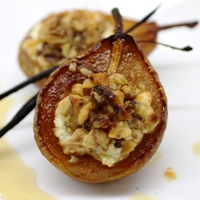 Image of maple caramelized pears stuffed with walnuts.
