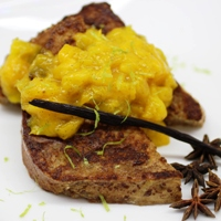 Image of a couple pieces of cardamom french toast topped with a spoonful of the mango lime chutney