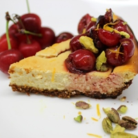 Image of a slice of the Sour Cherry & Pistachio Cheesecake