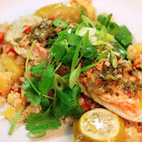 Image of thai napa wrapped fish with pineapple quinoa.