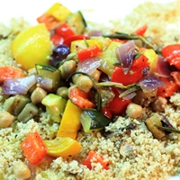Image of roasted summer vegetables with fluffy porcini couscous.