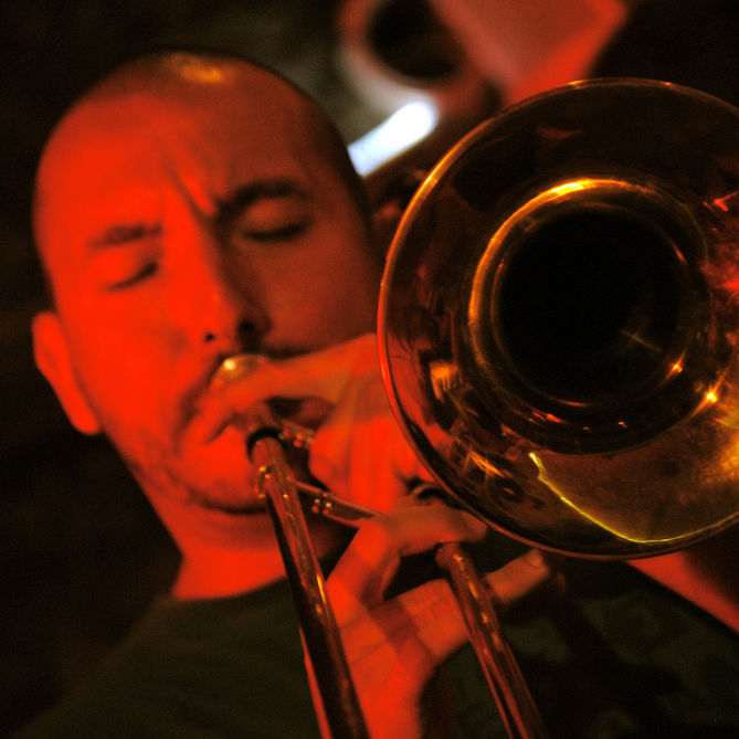 Image of man playing the trombone