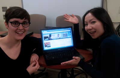 Image of Alaina and Aileen with a computer