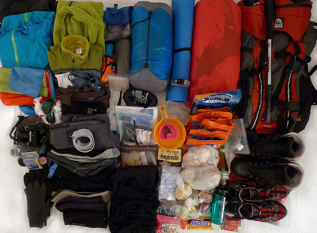 Image of rucksack with assorted camping gear